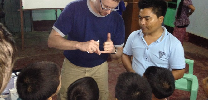 Little boys learn how to treat a skin disease