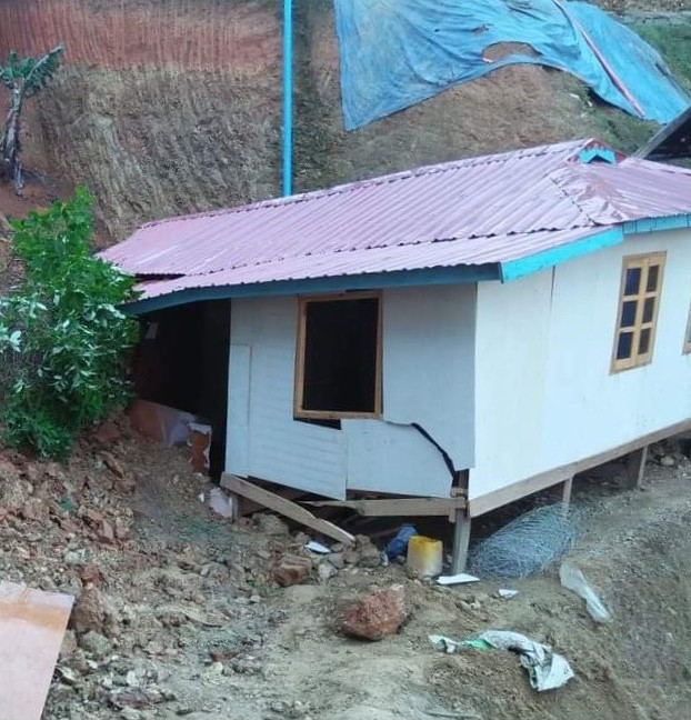 Naing Ha's house after it fell during the landslide
